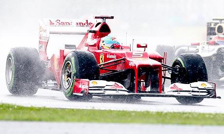 Fernando Alonso of Ferrari takes pole position at Silverstone for F1's British Grand Prix