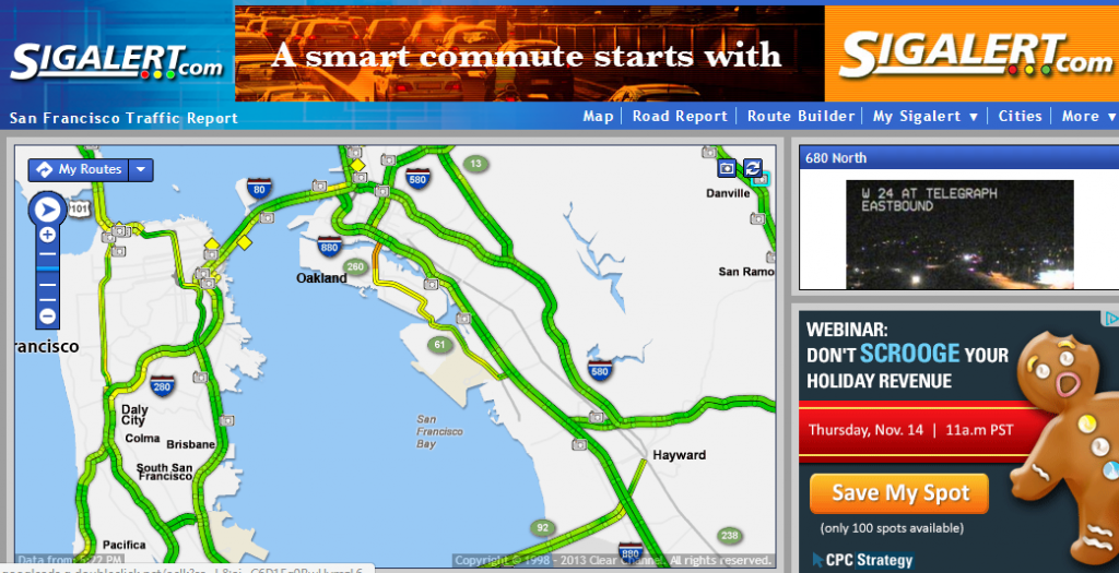 Sigalert.com shows a live interactive traffic map updated by their users, and offers a preview of the road conditions with their live traffic cam.